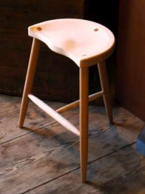 Custom sculpted wood stool by Paul Baines