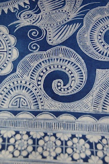 Chinese batik fabric; long strips of blue and white decorated fabric that were actually part of a large skirts