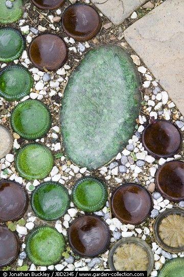 Decorative use of sunken, upturned bottles -