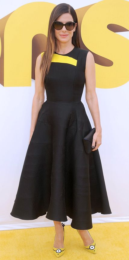 Sandra Bullock showed her commitment to her latest film Minions at the Los Angeles premiere, selecting a custom black silk Roksanda dress with a minion-yellow panel across the top, which she carried on over to her crazy cute custom minion-inspired Rupert Sanderson pumps.