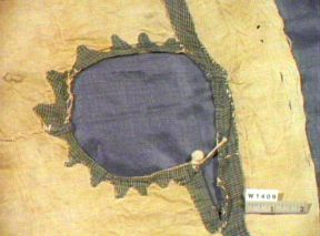 6th century EgyptianTunic with appliqué around neck in blue and white cotton check/plain fabric