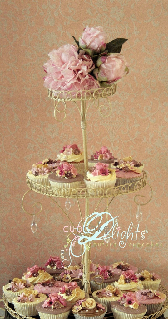 wedding cupcakes with delicate tiered stand.