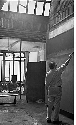 Rothko in his West 53rd Street studio, painting what may be a version of Untitled,1952-1953 (Guggenheim Museum, Bilbao), photograph by Henry Elkan, c. 1953