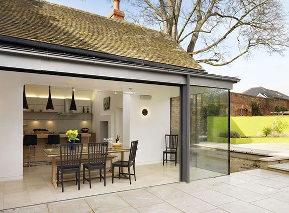 Track of glazed doors open across terrace  Glazed extension on Georgian townhouse in Berkshire bulthaup by Kitchen architecture #kitchens