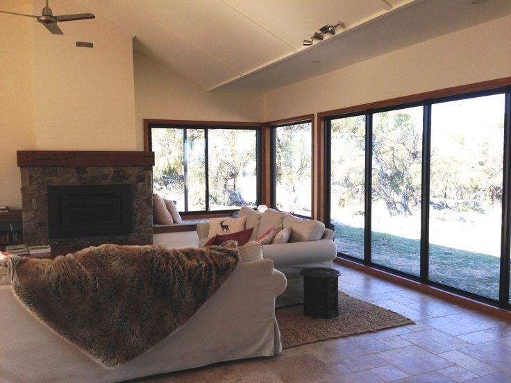 Living room - stone fireplace, timber sleeper mantle, brick chimney