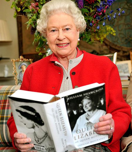 """~ Holding the book, """"QUEEN ELIZABETH THE QUEEN MOTHER,"""" the Queen smiles as she scans its pages for the camera. ~ The Queen has abandoned royal protocol to endorse an official biography of her mother. ~ HM chose to be pictured with it because she personally selected the author, William Shawcross"""