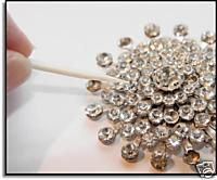 Vintage jewelry repair: How to re-glue rhinestones  Might be nice to try this for a future DIY jewelry project.