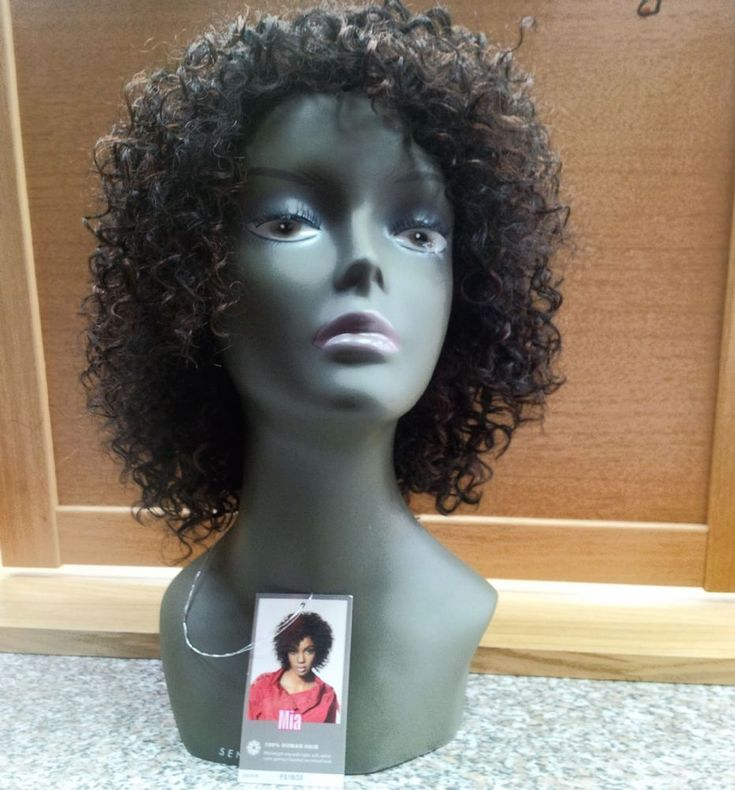 SLEEK 100 HUMAN HAIR SHORT CURLY WIG - MIA The Sleek 100 Human Hair wigs are made from high quality human hair and are made to look fully natural