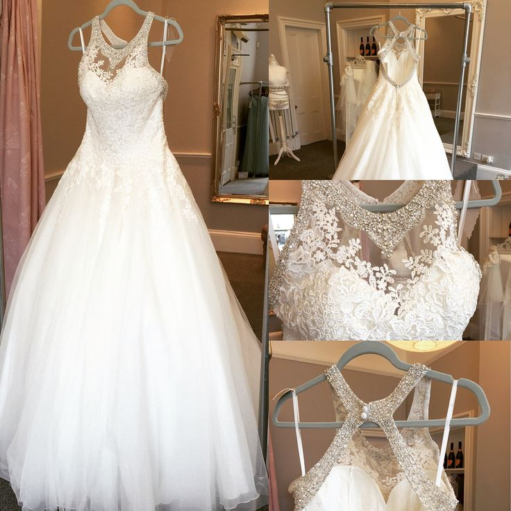 Ronald Joyce Wedding Dress Alma A tulle ball gown wedding dress which has the ever popular lace bodice The neckline has a very distinctive beaded effect and the open back cut is both stylish and enhancing.
