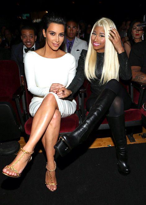 Kim Kardashian and nicki holding hands they're lesbians.
