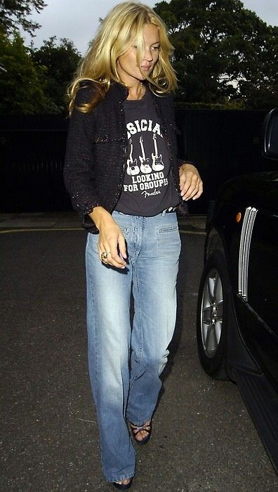 Kate in boyfriend jeans, heels and little jacket.