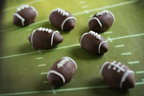Oreo (football) truffles: 1 pkg Oreos & 8 oz. cream cheese 1. Finely crush 7 cookies in a food processor. Reserve for later. 2. Crush remaining cookies and stir in 8 oz. softened cream cheese. 3. Shape the mixture into little footballs, dip once in chocolate, tap off extra and let dry. 4. Pipe rings on each end and the laces on top. #UltimateTailgate #Fanatics: Super Bowl, Recipe, Superbowl, Food, Football Truffles, Oreo Truffles, Party Ideas, Football Cake, Dessert