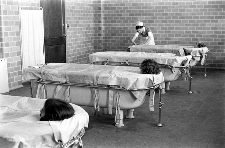 "Psychiatric patients at Pilgrim State Hospital, NY were put in a ""continuous-flow bath"" to calm them down. With their bodies greased, the patients can remain in the baths for hours until they fall asleep. 1938"