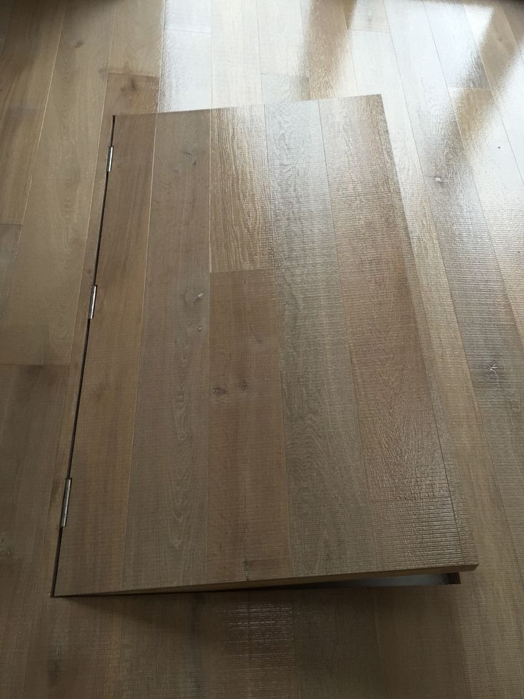 Some expert craftsmanship from our fitters. Have a look at this trap door within the newly fitted floor, leading to a wine cellar.