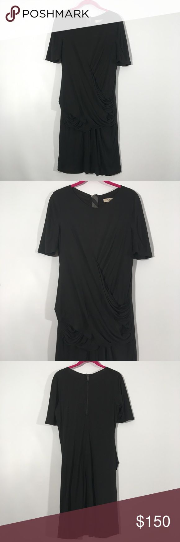 Burberry London Black Drape Casual Tee Dress M Spandexy material that fits near the body. Zips in the back. Drop falls across hips. Similar draping to the two styles shown in stock photos. Burberry Dresses Midi