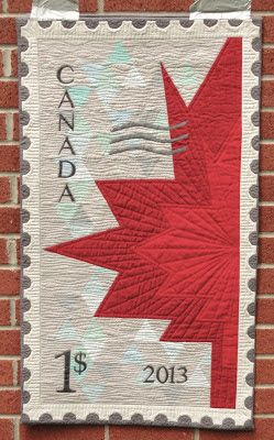 Don't want a Canada quilt, but would be good inspiration...to make a quilt from a postage stamp