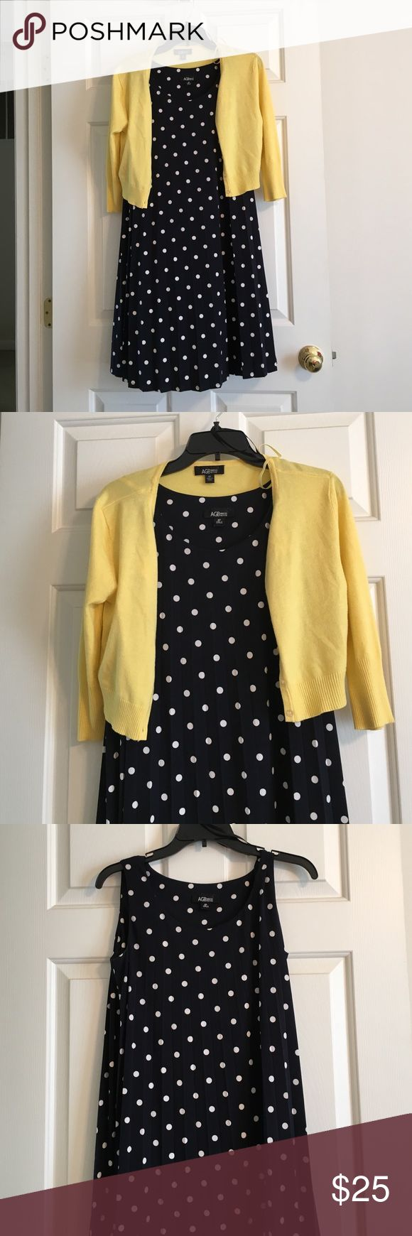 Petite blue polka dot dress Petite dress, navy and white polka dots with pleats. Comes with 3 qtr. sleeve yellow sweater. Only worn a few times. In great condition. AGB Dresses Midi