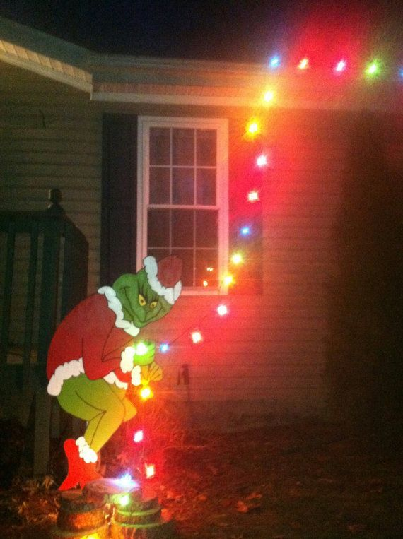 Holiday decorating just got easier! This four and half foot tall Grinch lawn ornament is perfect for outside your house. Add one strand of lights and it looks like the Grinch is at it again - stealing Christmas. Minimal effort decorating, but youll surely be the neighborhood hit!  Cut from AraucopPy, hand painted with exterior grade paint for outdoor durability. Wooden support supplied, some assembly required. *Second photo includes lights for illustrative purposes only. Hand is notched to…