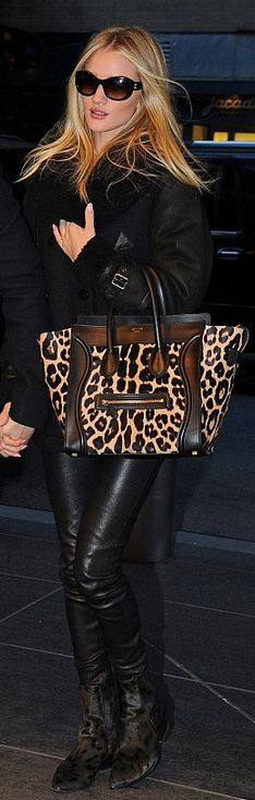 Who made  Rosie Huntington-Whiteley's black sunglasses, leopard tote handbag, print boots, and black coat that she wore in New York?