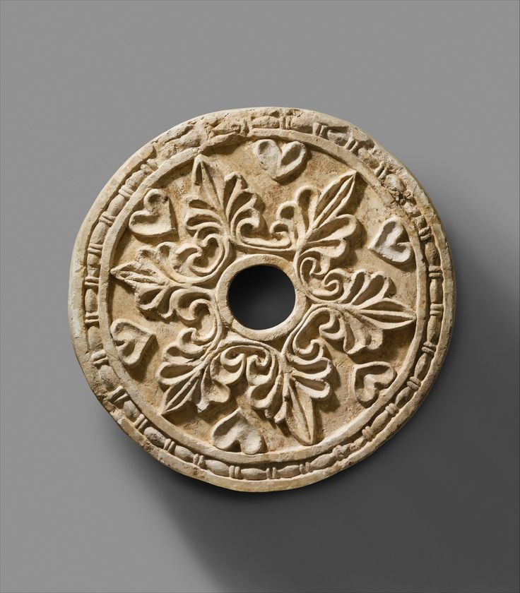 Roundel with radiating palmettes Period: Sasanian Date: ca. 6th century A.D. Geography: Mesopotamia, Ctesiphon Culture: Sasanian Medium: Stucco