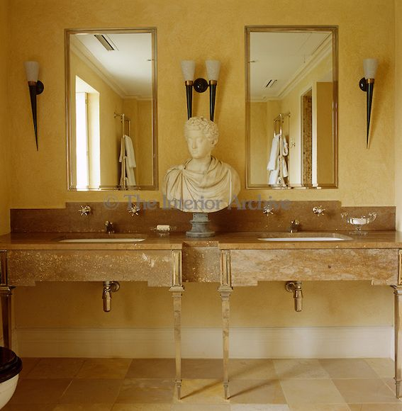 Alidad A Classical Bust Is Placed Between Two Basins In
