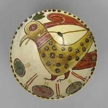 """A Nishapur Bird Bowl    A pottery bowl with hand painted interior depicting a bird, round bowl with small foot, approx. 3-1/2""""T x 8-1/8""""."""