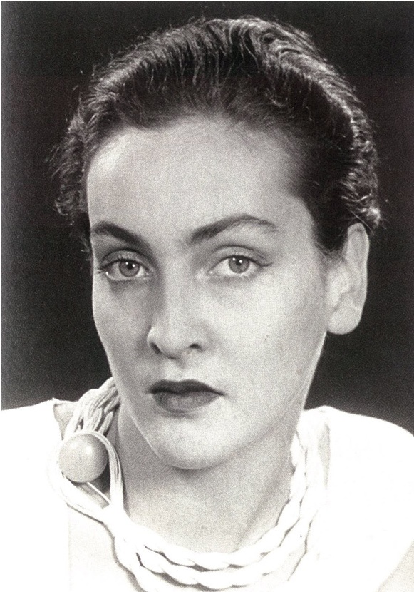 Meret Oppenheim (1913-1985) - German-born Swiss surrealist artist and photographer. Photo by Man Ray [1934].