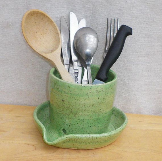 This is such an awesome idea!  https://www.etsy.com/listing/88405398/cutlery-drainer-utensil-jar-toothbrush