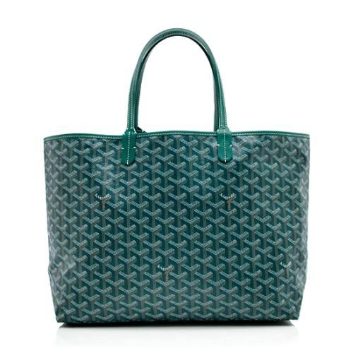 An iconic Goyard tote in green Goyardine canvas with tonal leather trim and silver-tone hardware. Details include double leather handles, a spacious beige canvas interior, and detachable pochette. The St. Louis PM is the smallest size of the design.