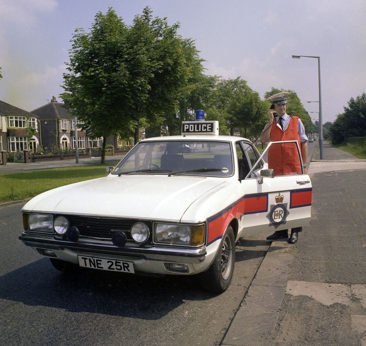Another classic image of road policing from the archives of the Greater Manchester Police Museum. This image comes from a series taken for a recruitment campaign back in 1979. A traffic officer, resplendent in his red high conspicuity vest, stands beside his vehicle on Mauldeth Road West in Chorlton-cum-Hardy. From the collection of the Greater Manchester Police Museum. www.gmpmuseum.co.uk