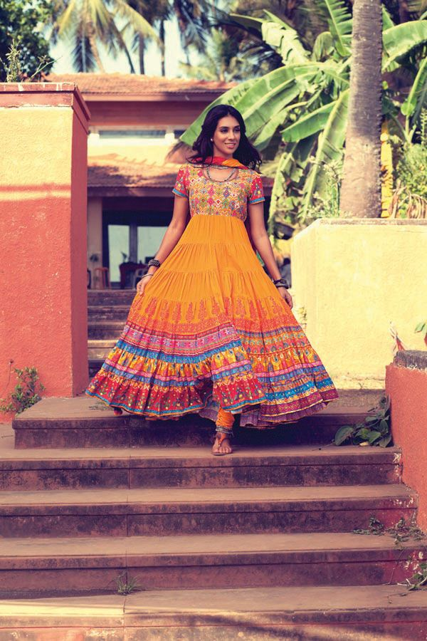 Walk+tall.+Walk+different.+Wear+the+swirly+elegant+charm+of+this+brick+warm+mustard+tiered+styled+kurta.+The+vibrant+kutch+prints+in+contrasting+colours+and+bold+block+print+would+neatly+add+to+your+charm.