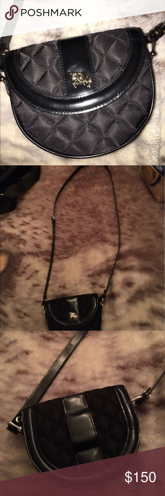 NWOT Burberry Purse Authentic Burberry Purse/ coin purse. Never used, fantastic condition. Black with detachable straps. NWOT Burberry Bags