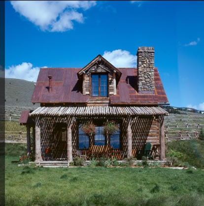 Tiny guest house....love the galvanized roof and log features over the porch.  Candace Miller Architects, Bozeman, Montana
