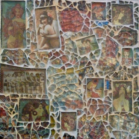 Glass mosaic with embedded photographs. Loving this.  Looks like shattered safety glass on top??