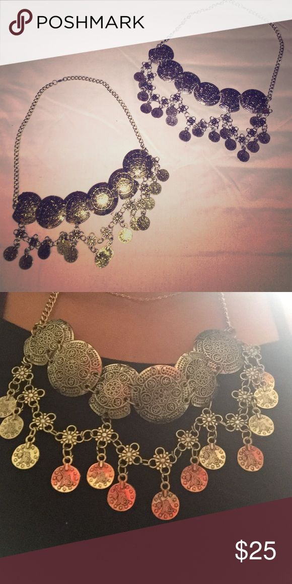 Metallic Accessory Necklaces Large circle design necklace, one is silver while the other is more brass colored. Both acquired in Cairo's historic Khan-el-Khalil market. Get one (or both!) to accent any outfit. Price listed is for each necklace Jewelry Necklaces