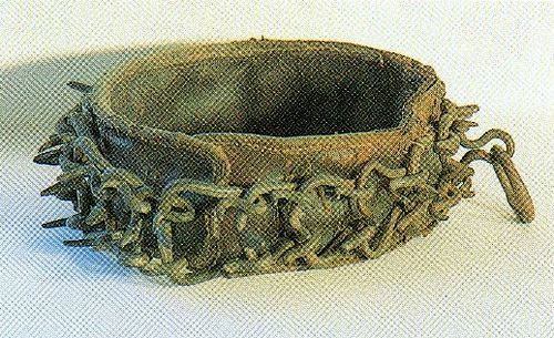 Tudor dog collar. There were several dog collars in Henry VIII's Inventory and 65 leashes for hounds which were kept in the closet next to the privy chamber at Greenwich. This is one of the few remaining items.