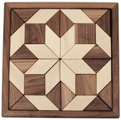 """Camden Rose Maple & Walnut 2-Sided Wood Mosaic Puzzle, 11.5"""" Square by Camden Rose. $59.99. Lovely square puzzle with geometric pieces. 11.5"""" x 11.5"""" x 1"""". Double sided maple and walnut puzzle pieces. Made in the USA. Gorgeous geometric mosaic puzzles feature multiple hardwoods. Triangles, squares and diamonds are arranged in a pleasing geometric form. You may also use the individual puzzle pieces to create tanagrams."""