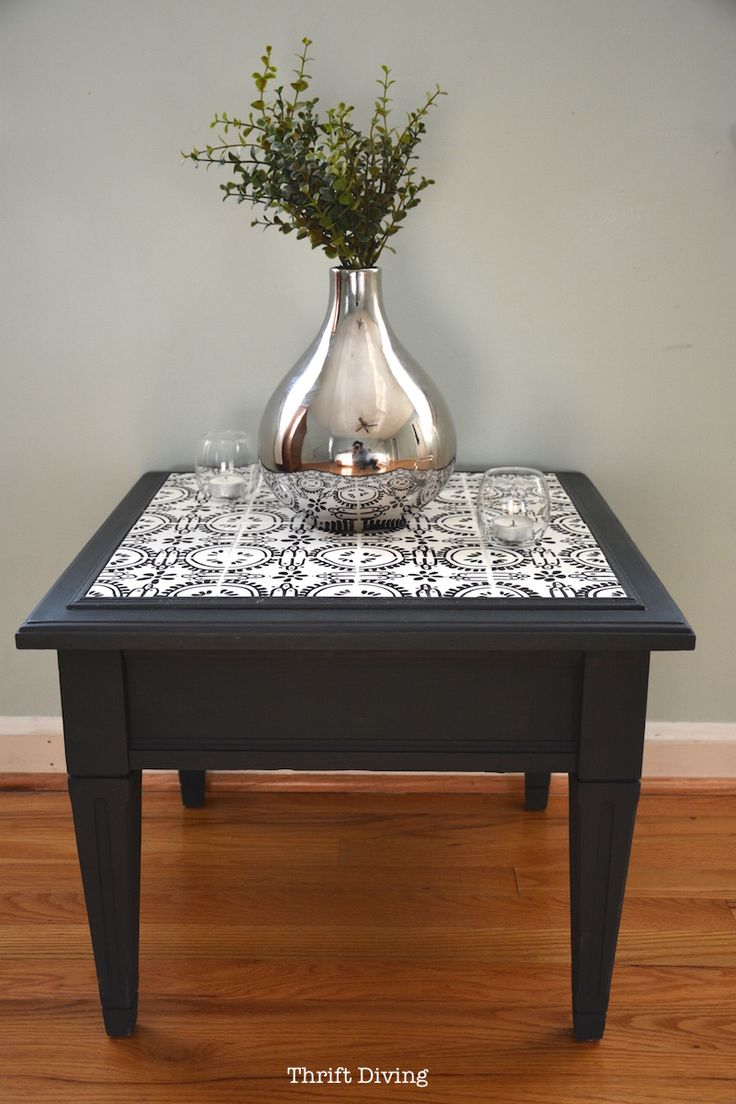Find an old table, some cheap 16 cent tiles from Home Depot, and a permanent marker, and you can easily tile a table top with your own ceramic tile designs!