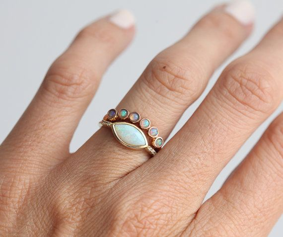 Unique and special Opal wedding band ring. Price for set is 1490$. If you would like to purchase set please contact me through etsy convo. ★Product details Gemstone: genuine Opals Measurements: 2 mm Band width: 1.80 mm Material: 14k rose/yellow/white gold, 18k rose/yellow/white gold for