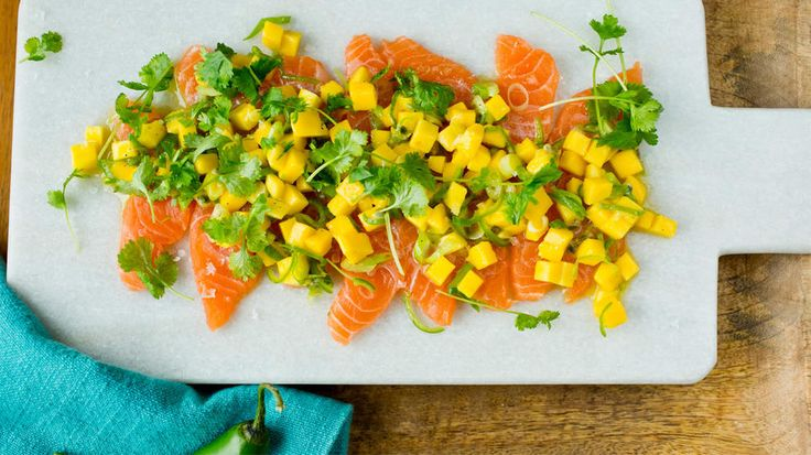Raw marinaded salmon with lime, mango and green chili...