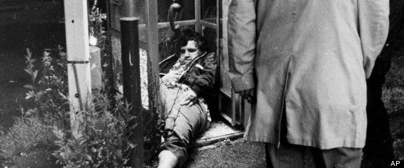 Edward Connors, an alleged victim of a fatal shooting by Whitey Bulger and Stephen Flemmi, slumped in a Dorchester phone booth in 1975. (AP Photo/File)