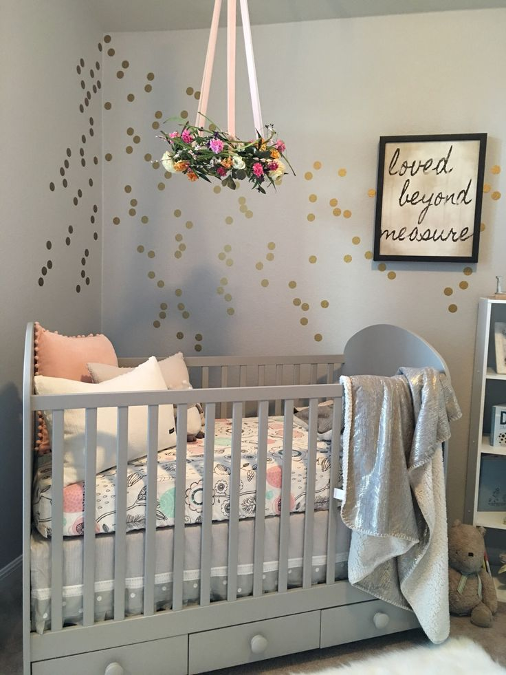 The Lolli Living Sparrow crib sheet and gray/gold metallic blanket brought the colors together. The pillows are Vera Wang from Home Goods Store; Eddie Bauer Owl Soother is from Target