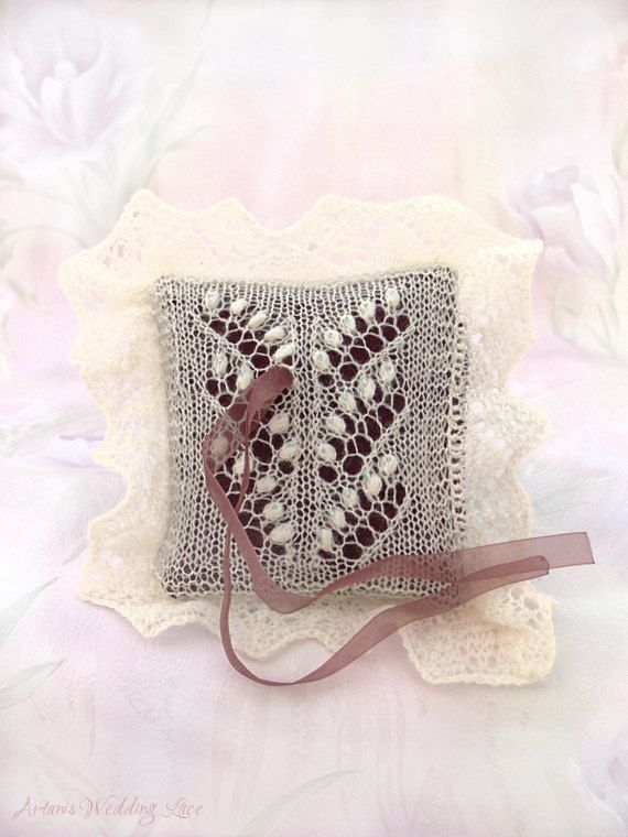 Hand-knitted elegant ring bearer pillow, inspired by Estonian lace knitting. It features the Lily of the Valley lace pattern with small blue glass beads.