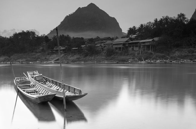 The fast flowing river bank in Nong Khiaw, Laos!  #Laos #NongKhiaw #LongExposure #Boat #Landscapes