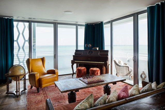 Living space at Soho House's Miami Beach House, bright colours make for a sunny space fitting the location. HOUSE - design, food and travel by House & Garden.