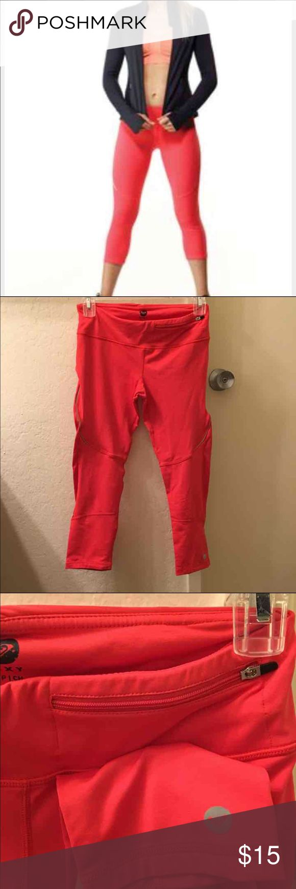 """Roxy coral Capri pants Coral color Capri work out pants. Features front pocket with zipper. Clinched back for a fitted look. Breathable material to wick away moisture. Worn one time to try on.   Size small. Length 27"""" inseam 20"""" Roxy Pants Track Pants & Joggers"""