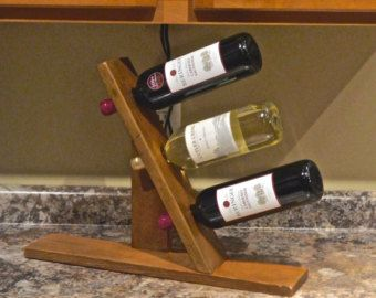 We did it! Saw this idea and ACTUALLY did one! This is beautiful if I do say so myself!! Tabletop, Countertop Wine Rack HANDMADE in Maine RECLAIMED WOOD, beautiful. $39