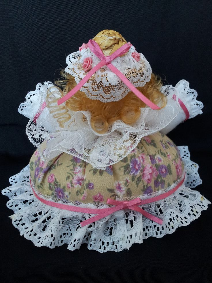 The Sweet Belle. Back view. Collectable Pin Cushion Doll. Material: Cotton & Lace. $25.00CAD + S/H if applicable. $0.00 Tax. Please contact Nola at: https://www.facebook.com/elegantcreationsbynola for purchase
