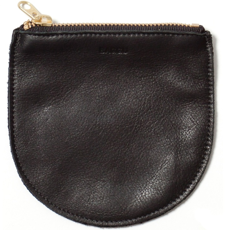 Leather Zip Pouch from Baggu. Rounded, flat bag is perfect size for cosmetics or as a clutch purse. Made from natural milled leather, handmade in New York City.
