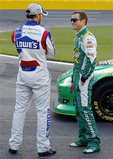 Jimmie Johnson #48 talks to Kasey Kahne #5 Quaker State Chevy during Qualifying for the Coca-Cola 600 on Sunday